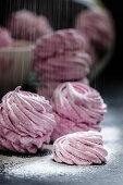 Pink zefir with powdered sugar