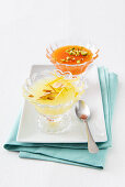 Lemon and orange granita in glass bowls