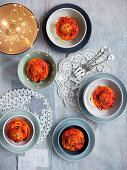 Spaghetti nests with meatballs and stemmed cabbage