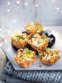 Filo pastry nests filled with pennette, fish fillet and bottarga