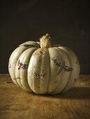 Pumpkin decoupaged with cut-out moths