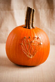 Pumpkin decorated with wire heart