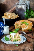 Crepes baked with salmon and broccoli
