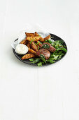 Spinach and feta steak with salty-sweet wedges