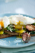Poached eggs on toast with Spinach Sausage