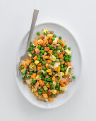 Peas and carrot cubes with egg and onion
