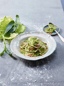 Sweet potato and spelt ravioli with cabbage pesto and pine nuts