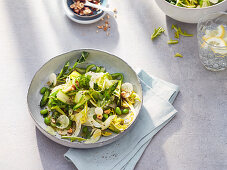 Spring salad with green asparagus, dandelions, fennel, broad beans and courgette