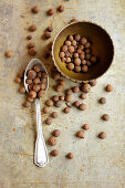 Allspice grains in a bowl and on a spoon