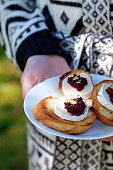 Crostini with goat's cheese, beetroot pesto and pistachios on toasted white bread