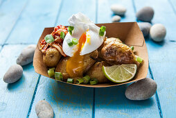 Fried potatoes with a poached egg and spring onions (Korea)
