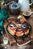 Chocolate buns with white chocolate glaze