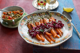 Roasted carrots with a beetroot and pomegranate sauce and peppermint