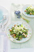 Puntarelle and fava bean salad with croutons and egg