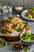 Chicken quesadillas with corn and broad bean and avocado salsa