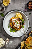 Broad bean fritters with herbs, bacon and goat's cream cheese