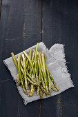 Green mini asparagus on towel