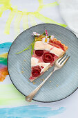 A slice of rhubarb rose cake for Mother's Day on a plate