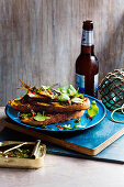 Grilled sardines on toast with Salmoriglio
