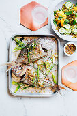 Baked snapper with chickpea salt and freekeh salad
