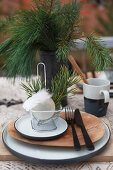 Christmas place setting decorated with fryer basket, bauble and feathers
