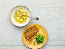 Vegetable broth with custard royale served with wholemeal bread