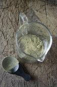 Matcha tea powder in a glass jug