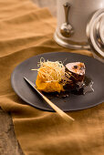 Coffee veal fillet with pumpkin purée and fried leek