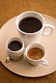 Espresso, cafè americano and mocha in white cups