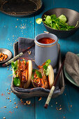 Gua Bao filled with octopus and bacon, served with salsa
