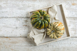 Microwave gourds on a rustic wooden background