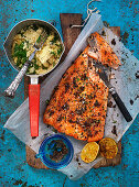 Oven roasted salmon fillets with herb couscous and grilled lemons