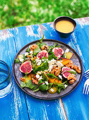 A colourful salad with figs, oranges, walnuts and feta cheese