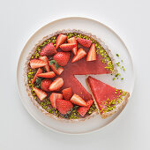 Strawberry and pistachio tart