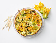Frittata with courgette flowers, courgette, mozzarella and croutons