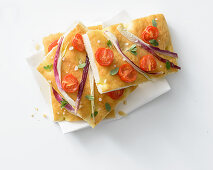 Spring onion focaccia with tomatoes and marjoram