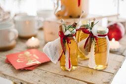 Bottles of apple juice as guest favours