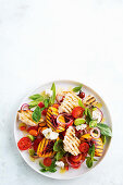 Panzanella with grilled peaches, tomatoes and goat's cheese