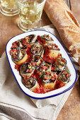 Melanzani a beccafico (stuffed aubergine rolls) with tomato sauce