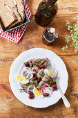 Beef salad with radishes, beans and egg