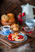 Scones with butter and strawberries