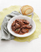 Cinghiale alla cacciatora (wild boar ragout with red wine, Italy)
