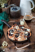 Chocolate snails baked in a pan with white chocolate