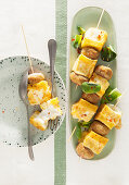 Cheesy bread and meatball skewers