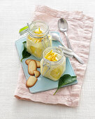 Lemon cream in jars with biscuits
