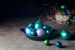 Easter background with painted Easter eggs in vintage style over dark background