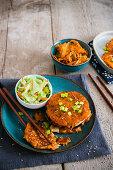 Korean pancakes with kimchi and salad
