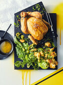 Roast chicken with bread, olive and lemon stuffing; Bread, green tomato and olive salad