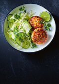 Green curry salmon cakes with cucumber and apple salad