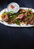 Spiced lamb cutlets with snake bean curry
